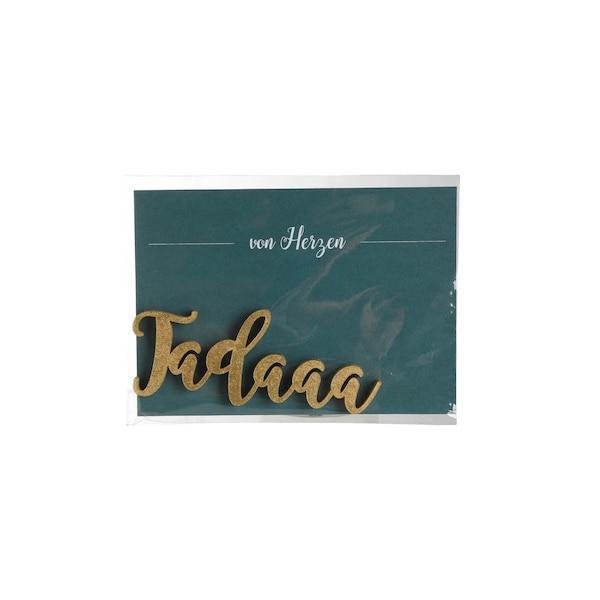 Schriftzug Tadaaa, gold
